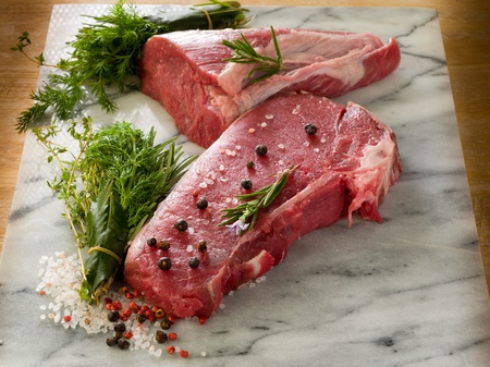 boned: raw porterhouse and tenderloin with mixed herbs juniper berry,pepper, salt