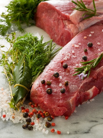 raw porterhouse and tenderloin with mixed herbs juniper berry,pepper, salt photo