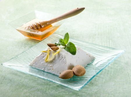 sicilian: ricotta pudding with almond, honey and mint leaf