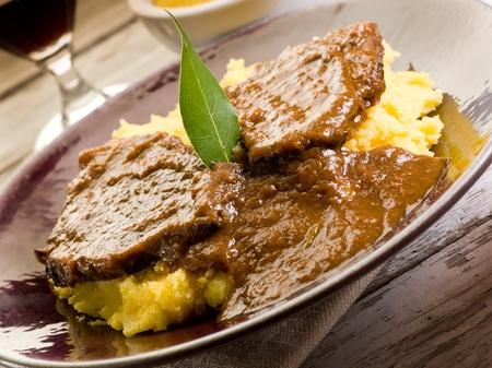 braised meat with  porridge photo