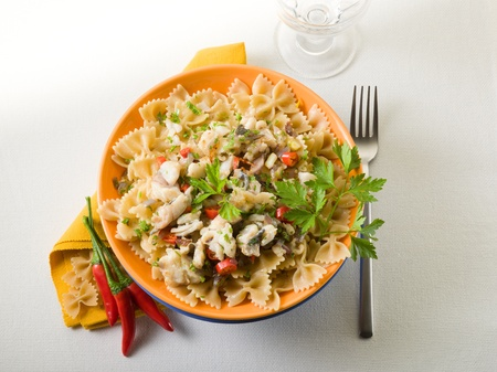 pasta with hake hot chili pepper and parsley photo
