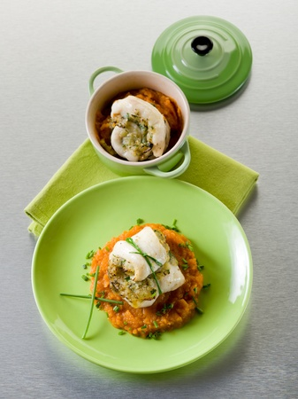mashed: cod fillet stuffed with herbs over mashed carrot, healthy food