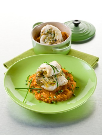 cod fillet stuffed with herbs over mashed carrot, healthy food photo