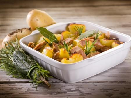 christmas grounds: roasted potatoes with tuna and rosemary Stock Photo