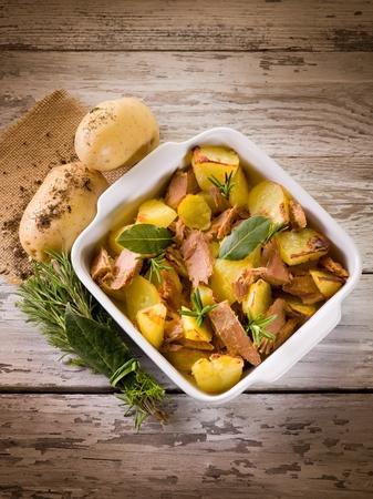 potato tuna: roasted potatoes with tuna and rosemary Stock Photo