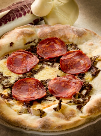 scamorza cheese: pizza with hot salami and scamorza cheese