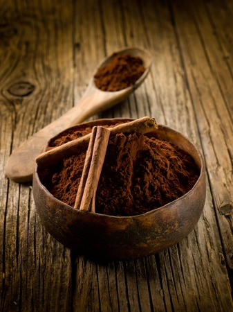 cacao powder with cinnamon on wood bowl photo