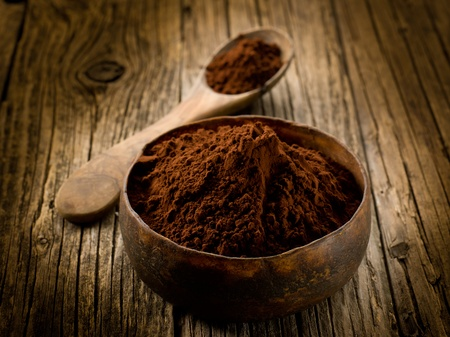 dry powder: cacao powder on wood bowl Stock Photo