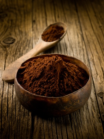rich flavor: cacao powder on wood bowl Stock Photo
