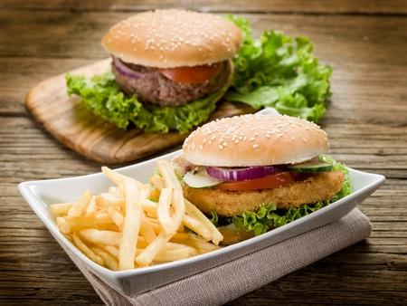 sandwich hamburger with chicken  potatoes and salad photo