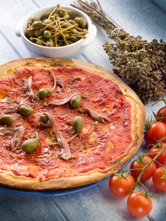 pizza with capers and anchovies photo