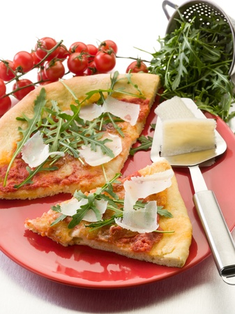 Pizza with arugula and parmesan cheese photo