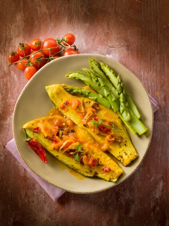 sea bass: fish fillet with tomato hot chili pepper and asparagus Stock Photo
