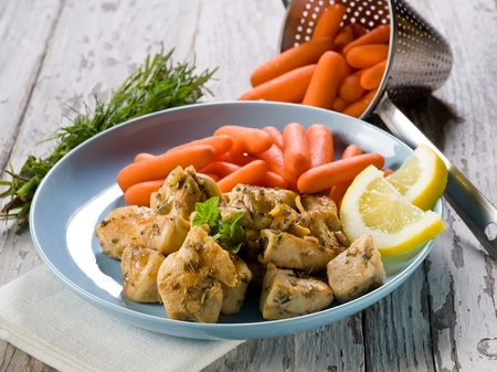 chicken  stew with herbs and small carrots  photo