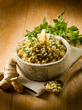 exotically: risotto with ginger and parsley, healthy food Stock Photo