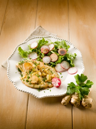 cutlet with ginger green salad and radish photo
