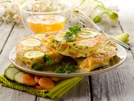 omelette with carrot zucchinis and parsley photo