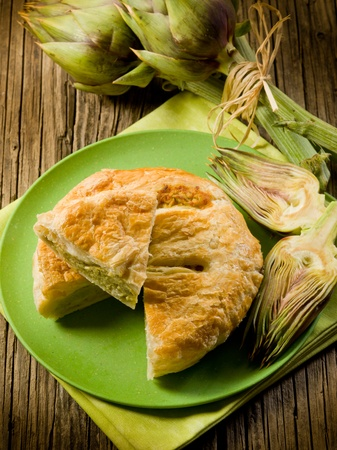 vegetarian quiche with artichoke on wood background photo