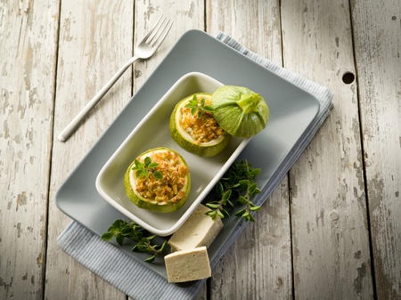 marrow squash:  Zucchinis stuffed with tofu cheese, vegetarian food Stock Photo