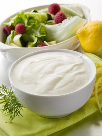 eating yogurt: white yogurt dressing for salad, healthy food