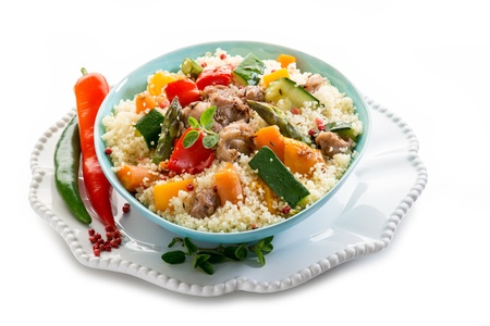 cous cous with meat  and vegetables photo
