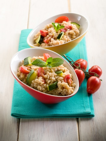 risotto: barley risotto with zucchinis and fresh tomatoes