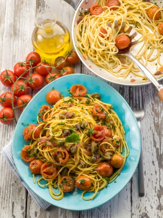 guitar spaghetti with pachino tomatoes and capers Stock Photo - 13711039