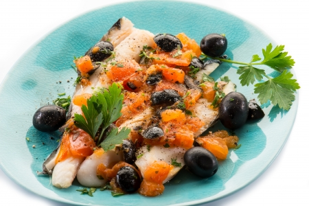 cod oil: fish fillet with tomatoes balck olives and pepper