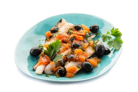 hake: fish fillet with tomatoes balck olives and pepper