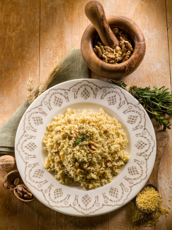 couscous: bulgur with nuts and herbs, vegetarian food Stock Photo