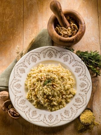 bulgur: bulgur with nuts and herbs, vegetarian food Stock Photo