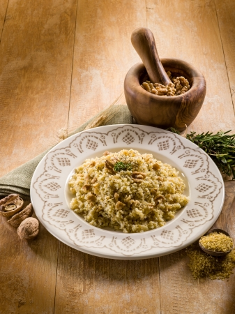 bulgur with nuts and herbs, vegetarian food photo