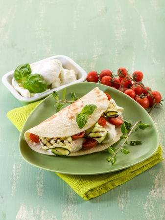 piadina with mozzarella, grelled zucchinis and tomatoes,  typical italian sandwich photo