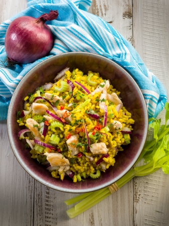 rice salad with chicken celery onions and chili pepper photo
