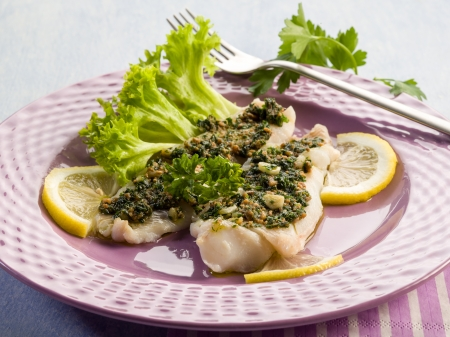 cod fish: cod fillet with parsley anchovy and capers Stock Photo