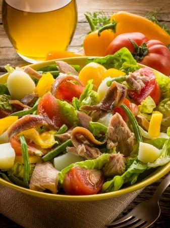 potato tuna: nicoise salad over wood background