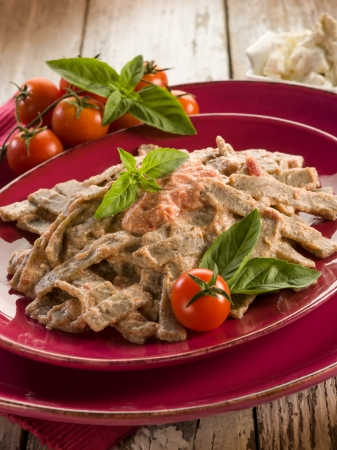 pizzoccheri with tomato and ricotta sauce