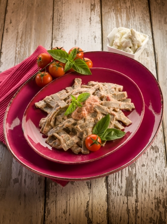 pizzoccheri with tomato and ricotta sauce photo