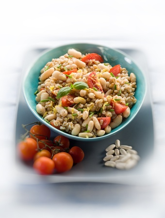 spelt risotto with beans and tomatoes, selective  focus, photo