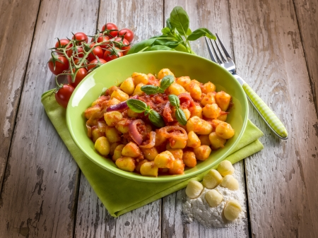 gnocchi: homemade gnocchi with tomato sauce basil and onions Stock Photo