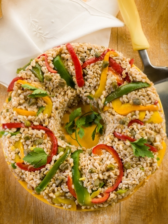 spelt doughnut with capsicum capers and parsley, vegetarian food photo