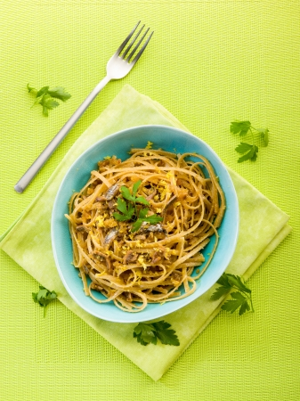 spaghetti with anchovy, grated bread and lemon peel photo