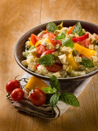 couscous: vegetarian couscous with tofu capsicum tomatoes mint and capers Stock Photo
