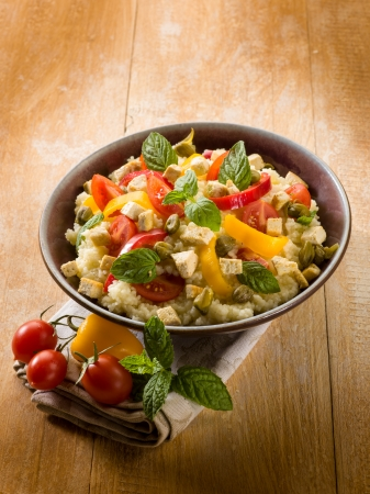 vegetarian couscous with tofu capsicum tomatoes mint and capers photo