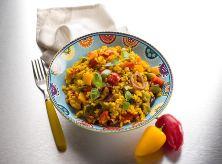 risotto with saffron and capsicum over steel background photo