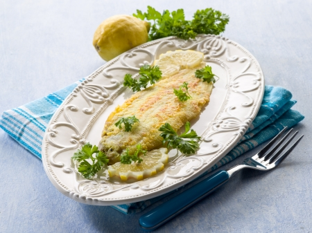 breaded sole fish with parsley and lemon Stockfoto