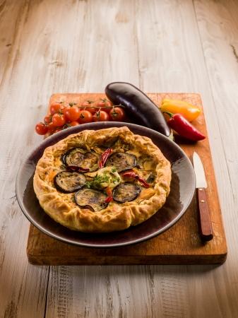 cake with ricotta eggplants and capsicum, vegetarian food photo