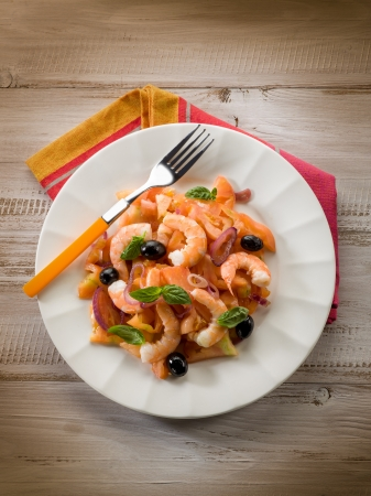 salad with shrimp tomatoes and black olives photo