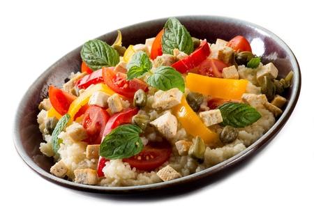 vegetarian couscous with tofu capsicum and mint leaf Standard-Bild