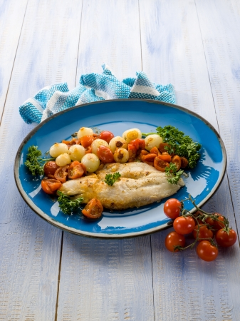 cod fish: cod with onions and tomatoes sauce